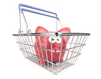 Piggy Bank in Shopping Basket Stock Photo