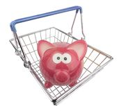 Piggy Bank in Shopping Basket Royalty Free Stock Photography