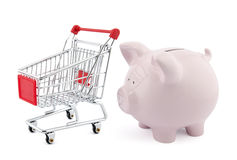 Piggy bank with shopping cart Stock Images