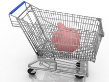 Piggy bank in a shopping cart Royalty Free Stock Photos