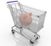 Piggy bank in a shopping cart Royalty Free Stock Images