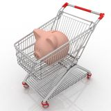 Piggy bank in a shopping cart Royalty Free Stock Photography