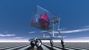 Piggy bank in shopping cart Royalty Free Stock Images