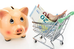 Piggy bank and shopping cart with Euros Royalty Free Stock Image