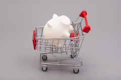 Piggy bank in shopping cart Stock Photography