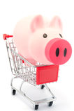 Piggy bank in shopping cart Royalty Free Stock Photos