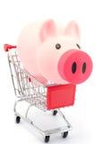 Piggy bank in shopping cart Royalty Free Stock Photos