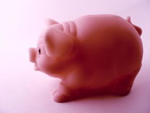 Piggy Bank Side View. Piggy bank with pink tint Royalty Free Stock Images
