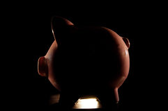 Piggy bank in silhouette Stock Images