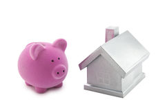 Piggy bank and silver house. With clipping path Royalty Free Stock Image