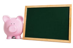 Piggy bank with small blank blackboard, school education savings fund planning concept Stock Image
