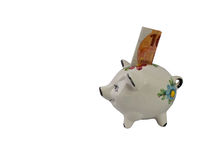 Piggy bank for small saver from side Stock Images
