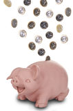Piggy bank smiling. On white background Stock Images