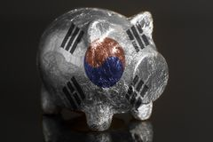 Piggy bank with South Korean Flag. On a black background royalty free stock photo