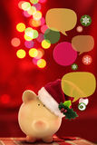 Piggy bank with speech bubbles. Christmas sale Stock Photos