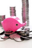 Piggy bank with stack of coins Royalty Free Stock Photo