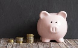 Piggy bank and stack of coins stock photos
