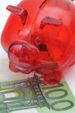 Piggy bank standing on a Euro banknote Stock Image