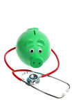 Piggy Bank and Stethoscope. On White Background Stock Photo