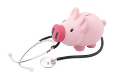 Piggy bank and stethoscope Stock Photography