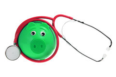 Piggy Bank and Stethoscope. On White Background Royalty Free Stock Photography