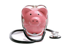 Piggy bank with stethoscope Stock Photo