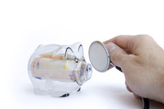 Piggy bank and stethoscope. Transparent Piggy bank and stethoscope Royalty Free Stock Photo