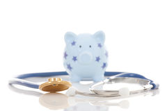 Piggy bank and stethoscope isolated. On white Stock Photo
