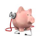 Piggy Bank and Stethoscope Stock Image