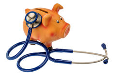 Piggy bank and stethoscope Royalty Free Stock Image