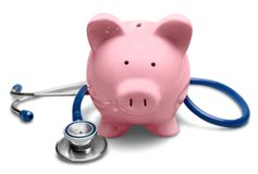 Piggy Bank with Stethoscope. Piggy bank finances stethoscope isolated financial health health insurance coin bank royalty free stock image