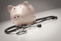 Piggy Bank and Stethoscope with Selective Focus Stock Images