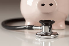 Piggy Bank and Stethoscope with Selective Focus Stock Photography