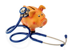 Piggy bank and stethoscope. A piggy bank and a stethoscope. symbolic photo for save in the doctor's office and secure investment Stock Images