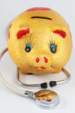 Piggy bank and stethoscope. On white background Stock Photos