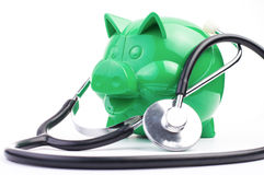 Piggy Bank With Stethoscope Stock Photos