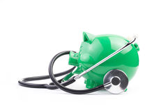 Piggy Bank With Stethoscope Royalty Free Stock Image