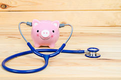Piggy Bank and Stethoscope. Stock Photos
