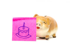 Piggy bank with stick. Piggy bank with birth day,s cake drawing paper note Stock Photography