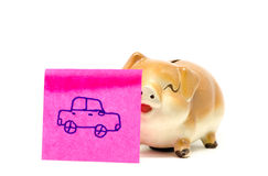 Piggy bank with stick Stock Image