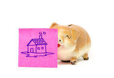 Piggy bank with stick Royalty Free Stock Photography