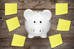 Piggy bank with sticky notes Royalty Free Stock Photography