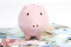 Piggy bank style money box on euros banknote Royalty Free Stock Photography