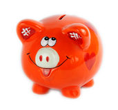 Piggy bank style money box on a white. Piggy bank style money box isolated on a white background, orange color Royalty Free Stock Photo