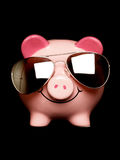 Piggy bank with sunglasses Royalty Free Stock Photos