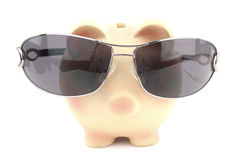 Piggy bank with sunglasses Royalty Free Stock Photo