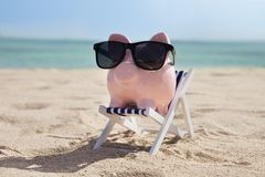 Piggy bank with sunglasses Stock Photos