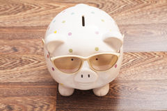 Piggy Bank with Sunglasses Royalty Free Stock Images