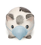 Piggy bank with a surgical mask Royalty Free Stock Photography