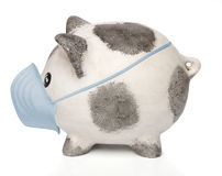 Piggy bank with a surgical mask Stock Images